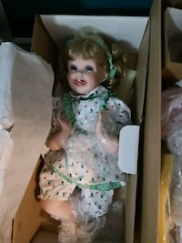 girl doll wearing white and green dress Edmonton, T5M 0L1