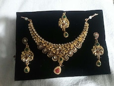 gold collar necklace an earrings