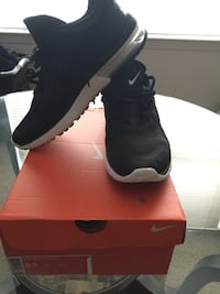 pair of black Nike sneakers with box