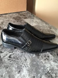 pair of black leather dress shoes Calgary, T3J 2X4