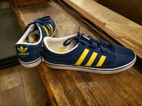 pair of blue-and-yellow Adidas sneakers Windsor