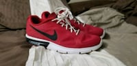 red-and-white Nike running shoes Independence, 64053