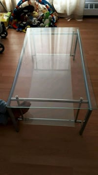 gray metal framed glass-top TV stand Montréal, H8S 1K8