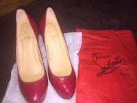 pair of red leather pumps 278 mi