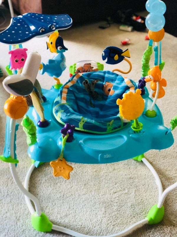 baby's blue and green jumperoo