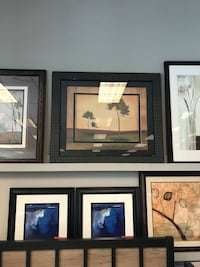 several assorted painting with black frames