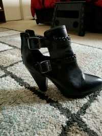 pair of black leather chunky heeled boots