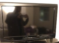 "Black 40"" flat screen tv with remote"