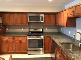 8*10 cherry kitchen with granite stainless steel appliances