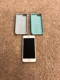 silver iPhone 6 with two gray and teal rear cases