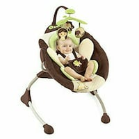 baby's brown and white cradle and swing