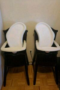 two white and black high chairs Columbia, 21044