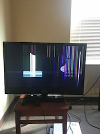black flat screen TV with black wooden TV stand New Albany, 47150