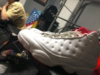 unpaired white and red Air Jordan 13 shoe Washington, 20024