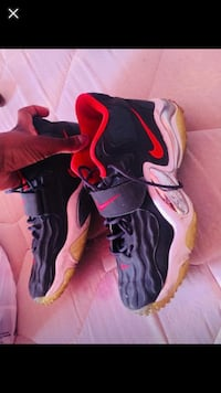 Pair of black-and-red nike basketball shoes Chicago, 60623