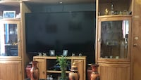 black wooden TV stand with flat screen television 205 mi