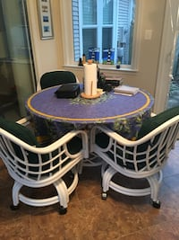 Glass dining table with four rolling chairs Woodbridge, 22192