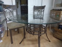 Ashley furniture glass table and 4 chair set  530 mi