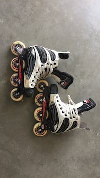 Pair of white-and-black inline skates null