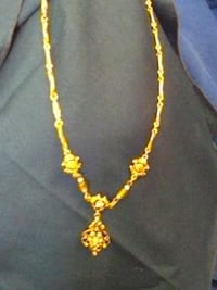 gold and black tone yellow necklace evening wear Edmond, 73034