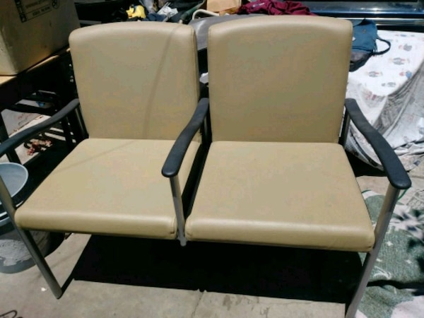 two brown metal framed bieige padded arm chairs 43788392-5661-4d05-bb10-7a2311a86d33