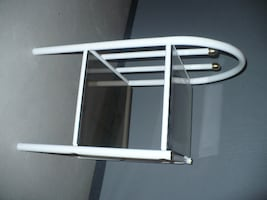 white metal shelf with tinted glass top