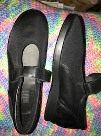 pair of black Drew Mary Jane flat shoes