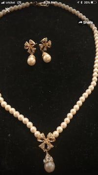 Pearl earrings and necklace matching set.