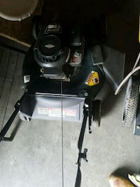 black and gray push mower 63 km