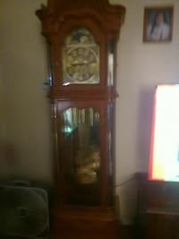 brown wooden grandfathers clock