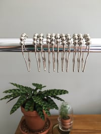 Stainless steel extendable shower rod w/ curtain rings