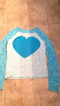 white and blue knitted sweater