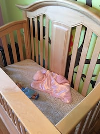 Two solid maple wooden convertible cribs