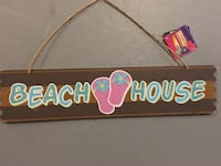 brown and blue Beach House signage