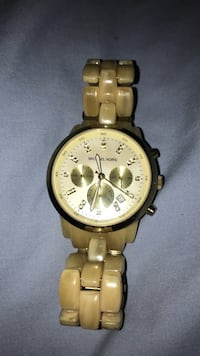 Round gold Michael Kors watch with gold link bracelet