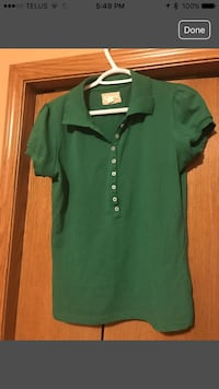 Women's green polo shirt. Calgary, T3G 3Y9