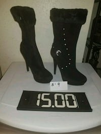 pair of black leather knee-high boots West Allis, 53219