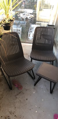 Black wicker chair with brown wooden frame Vancouver, V6E