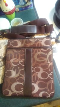 brown and black Coach monogram leather crossbody bag Calgary