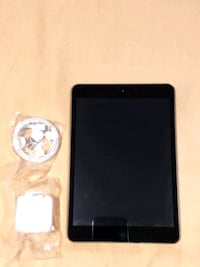 black iPad with charger and USB cable 246 mi