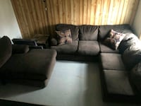 brown suede sectional sofa with throw pillows Nashville, 37013