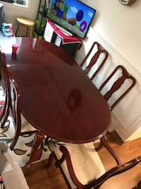 oval brown wooden table with six chairs dining set Cambridge, 02139
