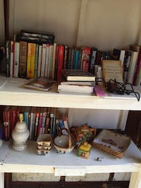 assorted books and white wooden shelf