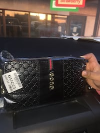 black Gucci leather wristlet Kitchener, N2E 4J5