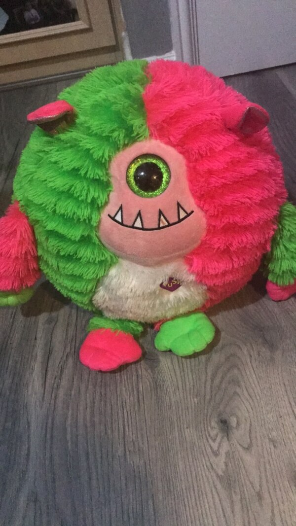 pink and green bear plush toy