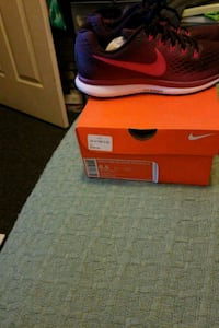 unpaired red Nike running shoe with box Paterson, 07514