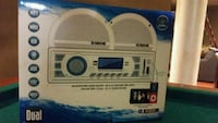 white and blue portable radio with auxiliary port. Nobleton, L0G 1N0