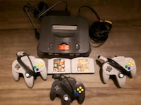 black Nintendo 64 console with controllers and gam Vancouver, V6B
