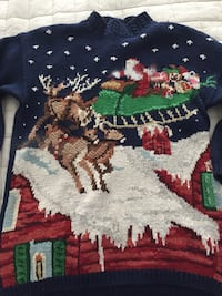 black, white and red christmas themed sweater