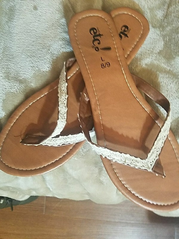 brown-and-white leather thong sandals